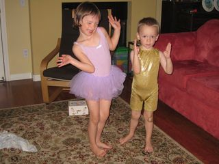 ballerina and solid gold robot